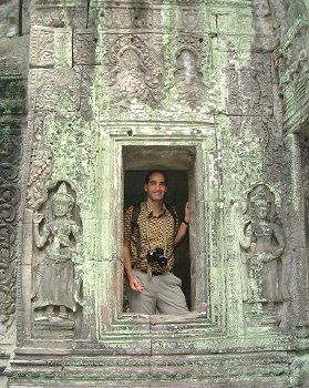Marc, standing in a window at Ta Prohm