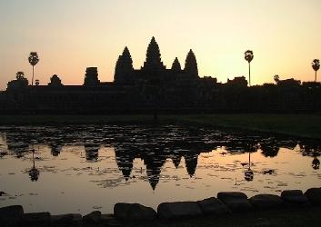 Angkor Wat shortly after sunrise, reflecting in pond out front