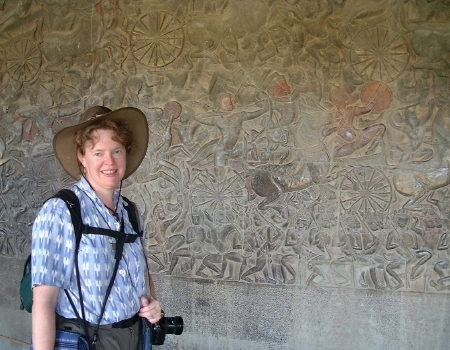Karen, in front of the western wall, with just a tiny portion of all the bas-relief carvings in view