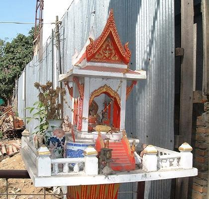 A small shrine, by a vacant lot in downtown Chiang Mai... not unlike ones you see all over Thailand