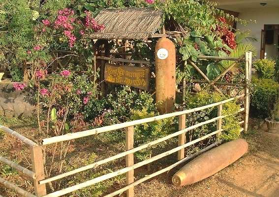 Old US bomb shells in front garden of Kong Keo guesthouse, Phonsavan