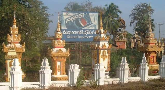 Outside Wat Than Fai, along with a Pepsi sign
