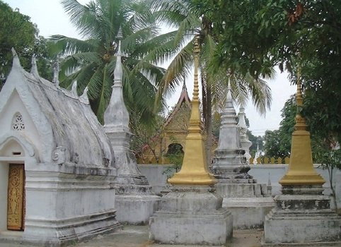 Stupas (white and gold) at Wat Mai Suwannaphumaham, Luang Prabang