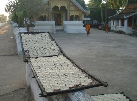 Rice cakes, drying outside a wat, late afternoon