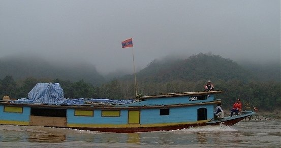 Another boat passing by, in the thick morning fog