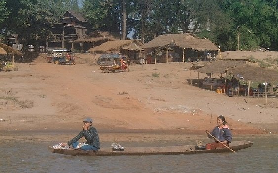 Lao man and woman in a small boat