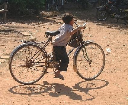Small boy on a big bike!  (Angkor, Laos)